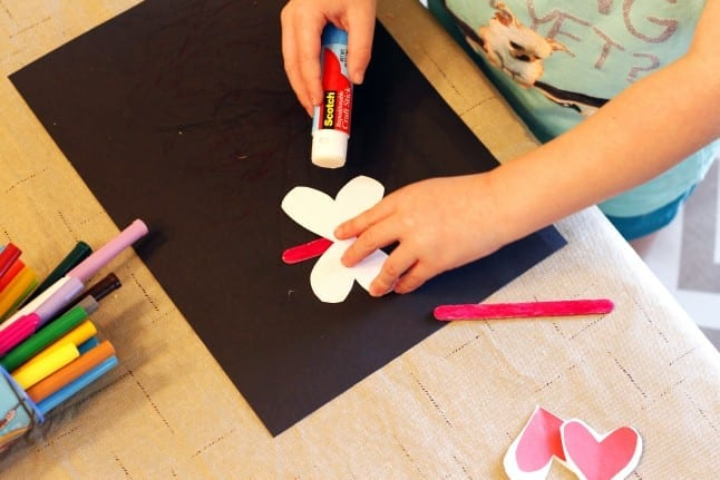 Gluing Love Bug Craft Together