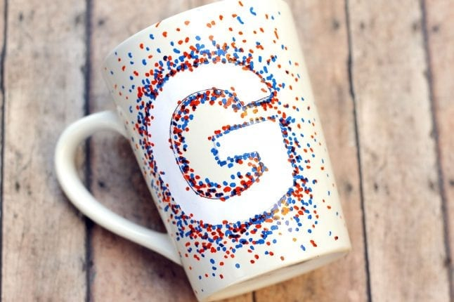Decorate your DIY coffee mug with oil-based paint pens.