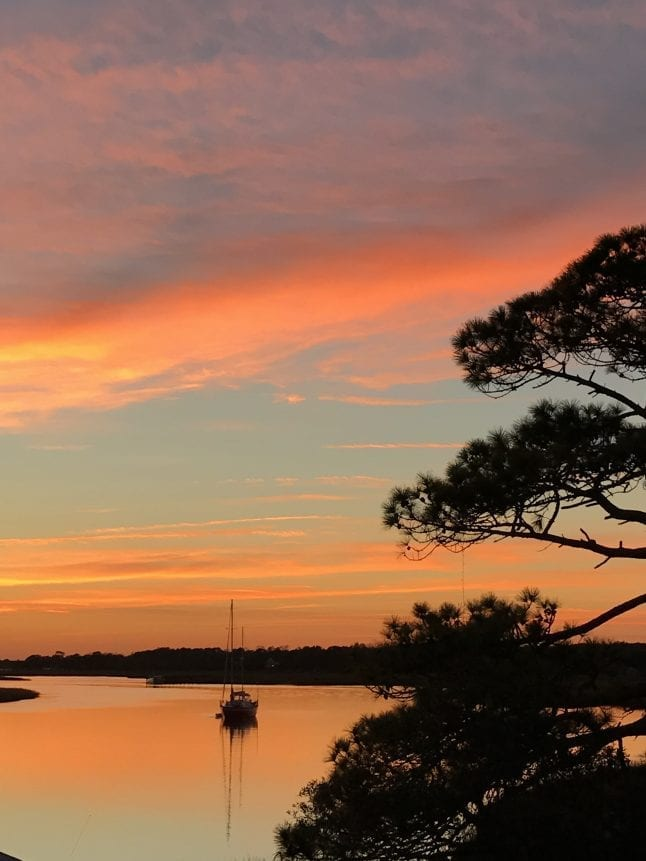 One of our favorite things to do in Charleston is visit Folly Beach and take in the sunset.