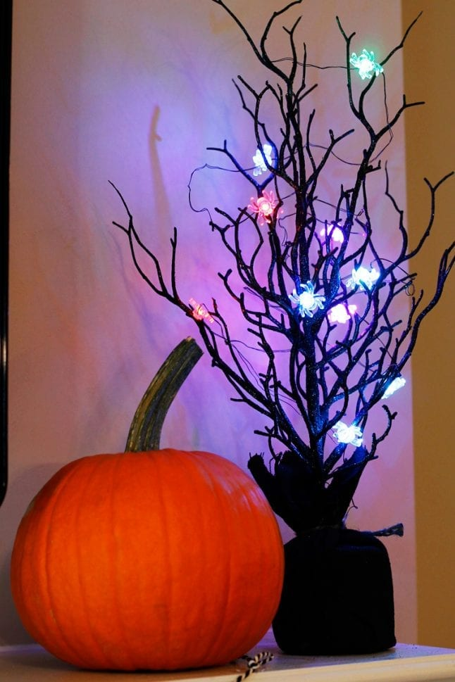 Halloween lights from the Dollar Spot make this mantle makeover even more festive.
