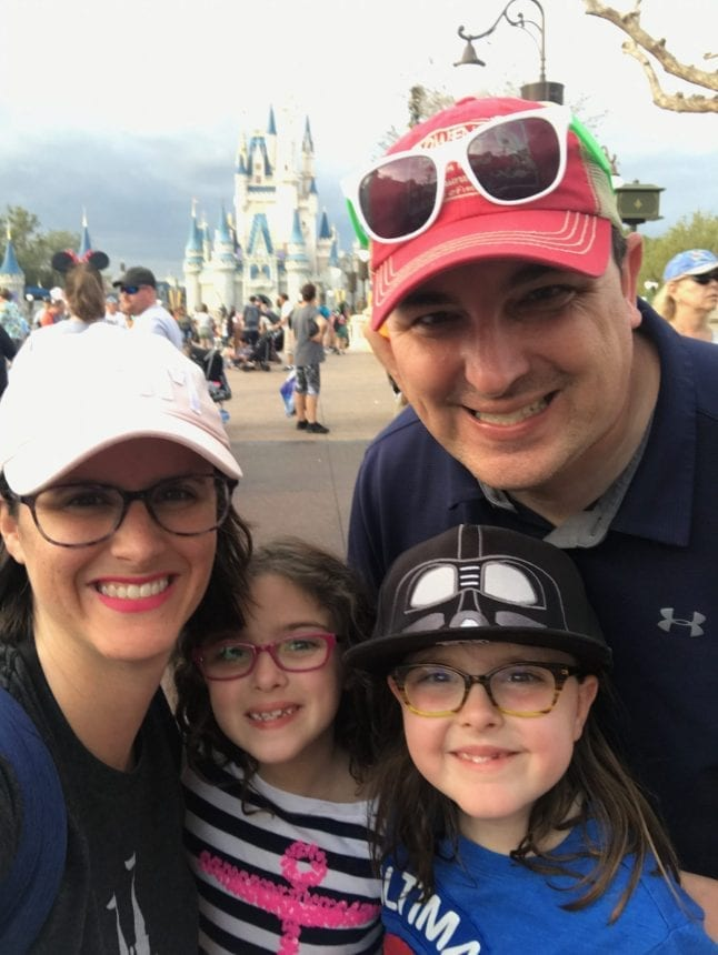 Family photo in front of the Disney Castle