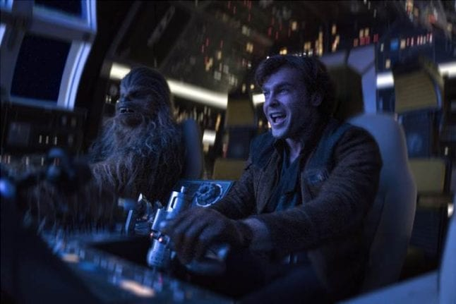 Han and Chewie in the cockpit of the Millenium Falcon in Solo: A Star Wars Story