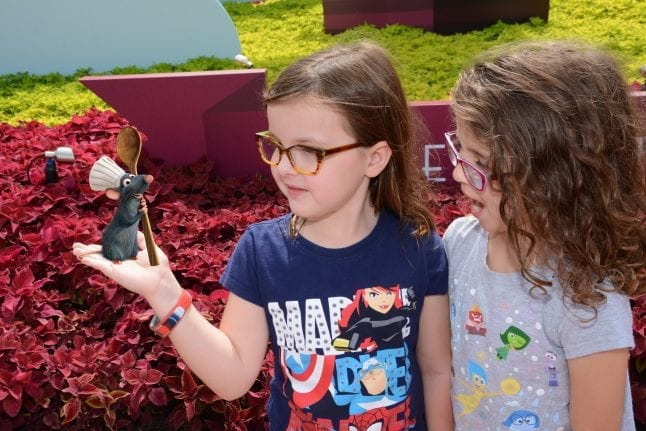 Fun photopass opportunities like this one with Remy happen during Epcot's Food and Wine Festival.