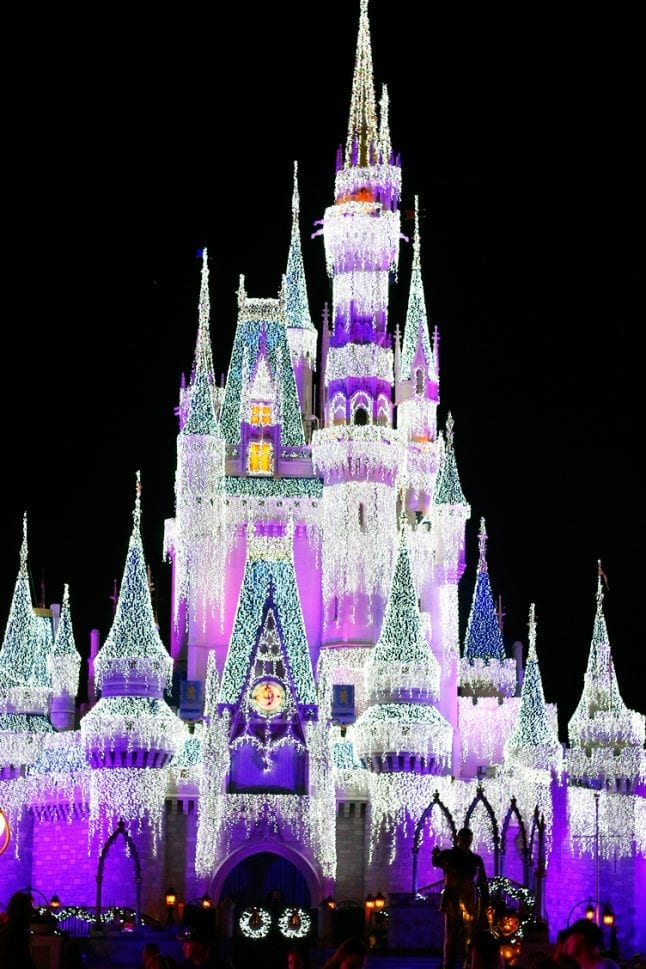 See Cinderella Castle frozen by Elsa during Mickey's Very Merry Christmas Party.