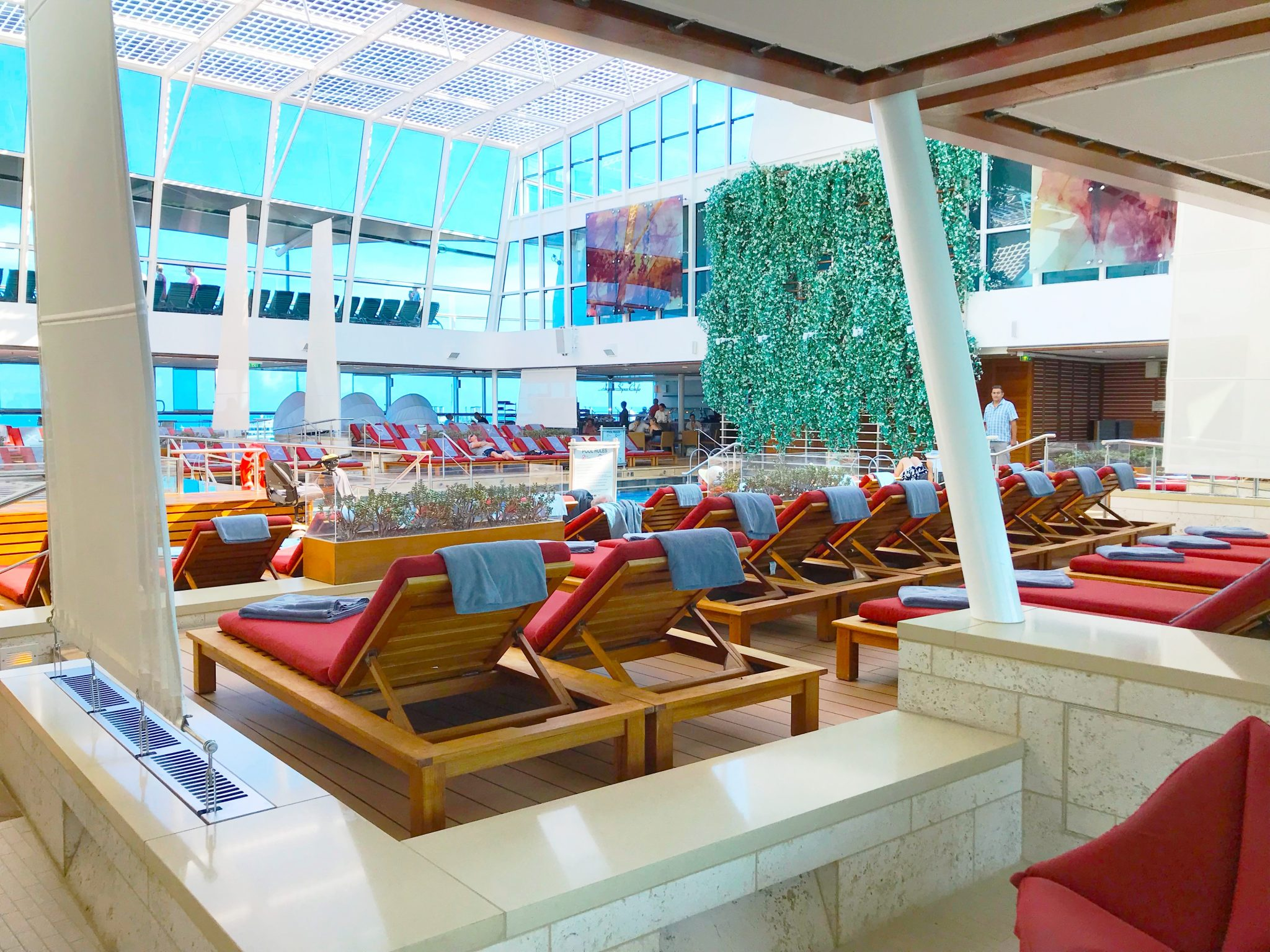Bask in the peace and serenity of Celebrity Reflection's Solarium.