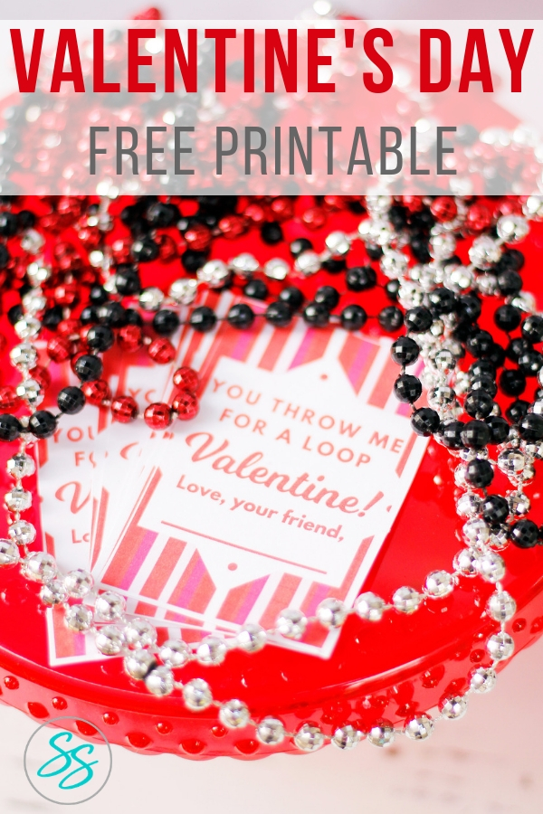 Need a free printable for Valentine's Day? How about a combination of holidays! Pay homage to Mardi Gras while simultaneously giving an awesome prize that kids will love. Parents will love you too for not giving candy! Grab this FREE printable Valentine's Day card today! #free #printable #valentinesday #mardigras