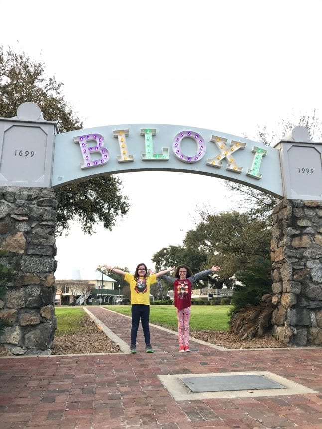 Posing in front of the light up sign for Biloxi, Mississippi