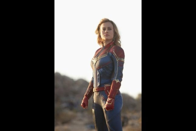 Captain Marvel in her blue, gold, and red suit.