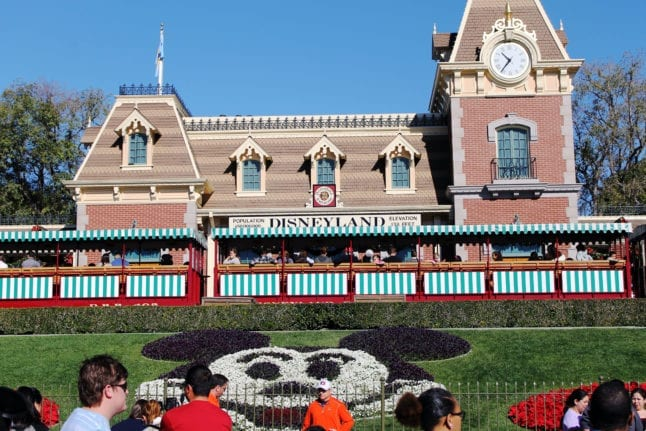 Front entrance of Disneyland Park looking at the railroad train and station.