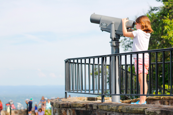Using a telescope to see the sights of Chattanooga from Lookout Mountain.