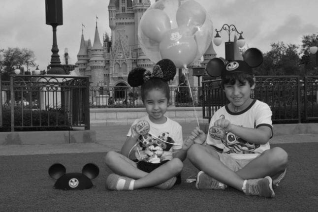 Black and white Disney themed baby announcement photo shoot.