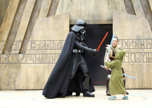 Battling Darth Vader at Jedi Training.