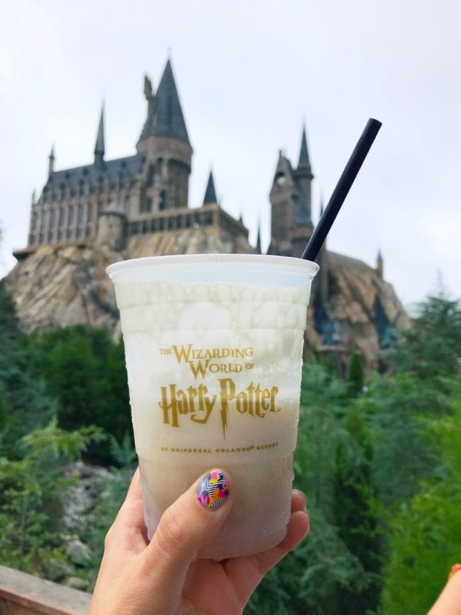 Frozen butterbeer drink in front of Hogwarts Castle at Universal Orlando Resort.