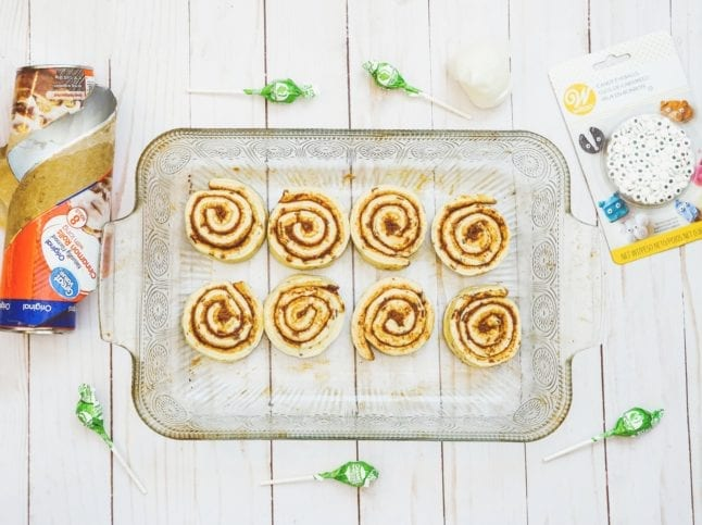 Bake cinnamon rolls according to package instructions