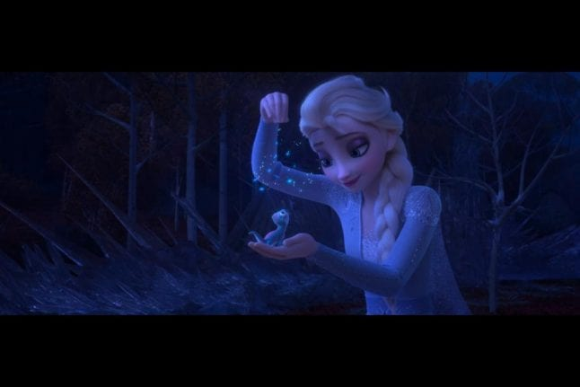 Elsa plays with the fire spirit in Frozen 2.