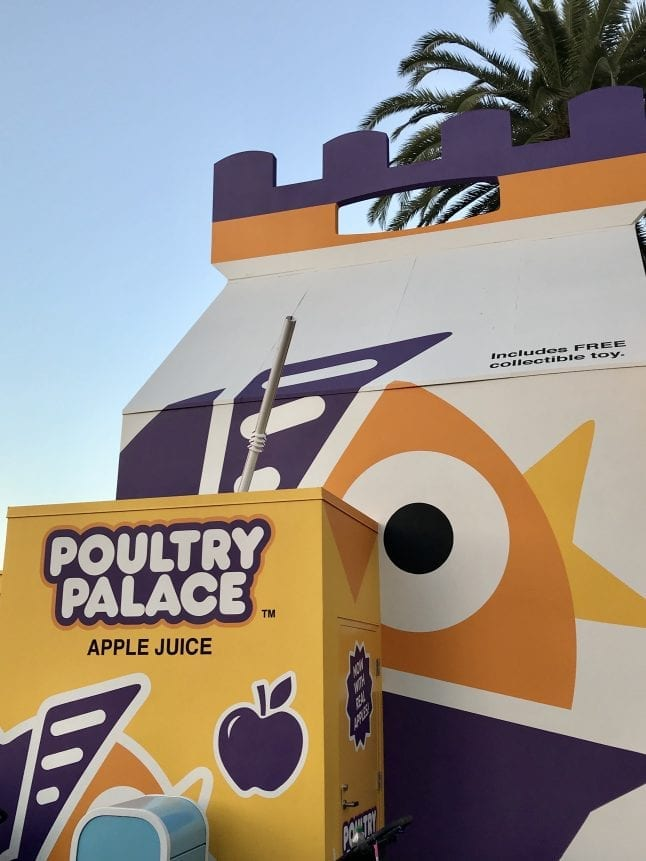 Poultry Palace Wall is located across from Toy Story Midway Mania.