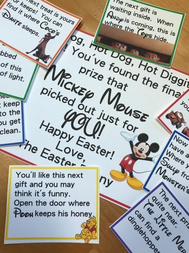 Disney themed egg hunt clues printed out a lying on a table.