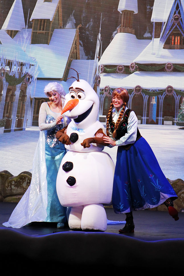 Elsa, Olaf, and Anna in Frozen show.