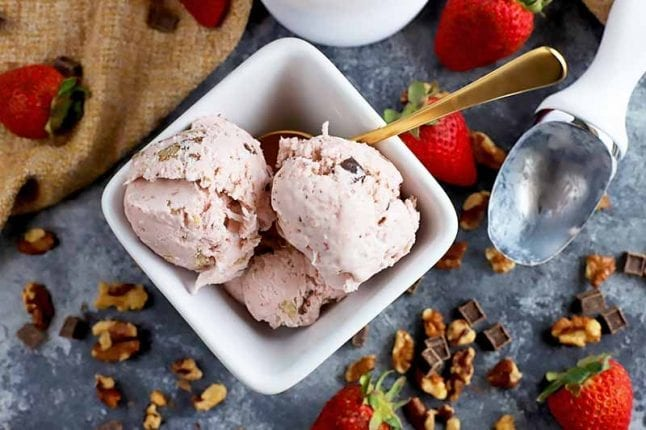 Strawberry ice cream with walnuts and chocolate chunks