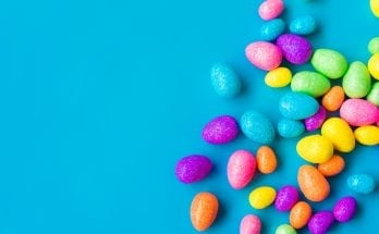 Glittering Easter eggs on a blue background.