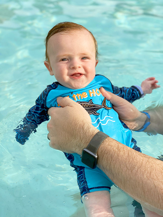 Enjoy a break with baby in the hotel pool at Disney World.