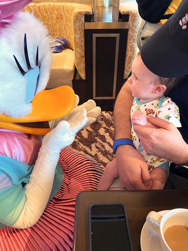 Babies are fascinated by characters at Disney World.