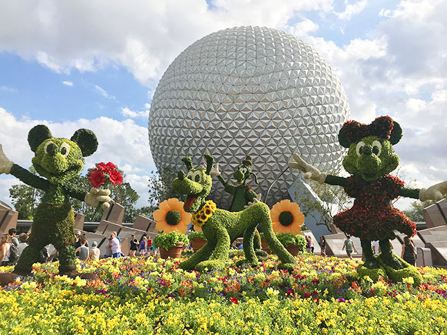 Epcot's entrance is decorated for Flower and Garden Festival.