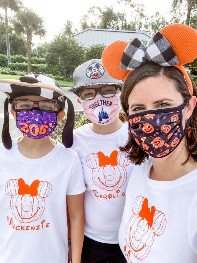 Mask wearing family at Disney World