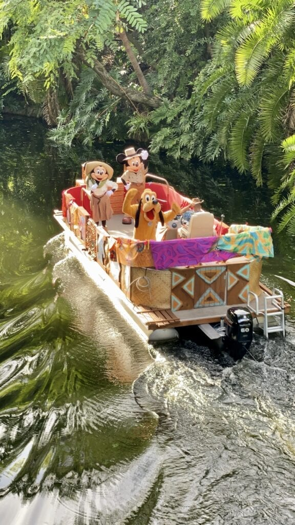 Mickey, Minnie, and Pluto on a boat ride around Animal Kingdom