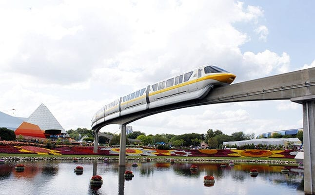 Yellow Monorail moving through Epcot at Disney World.