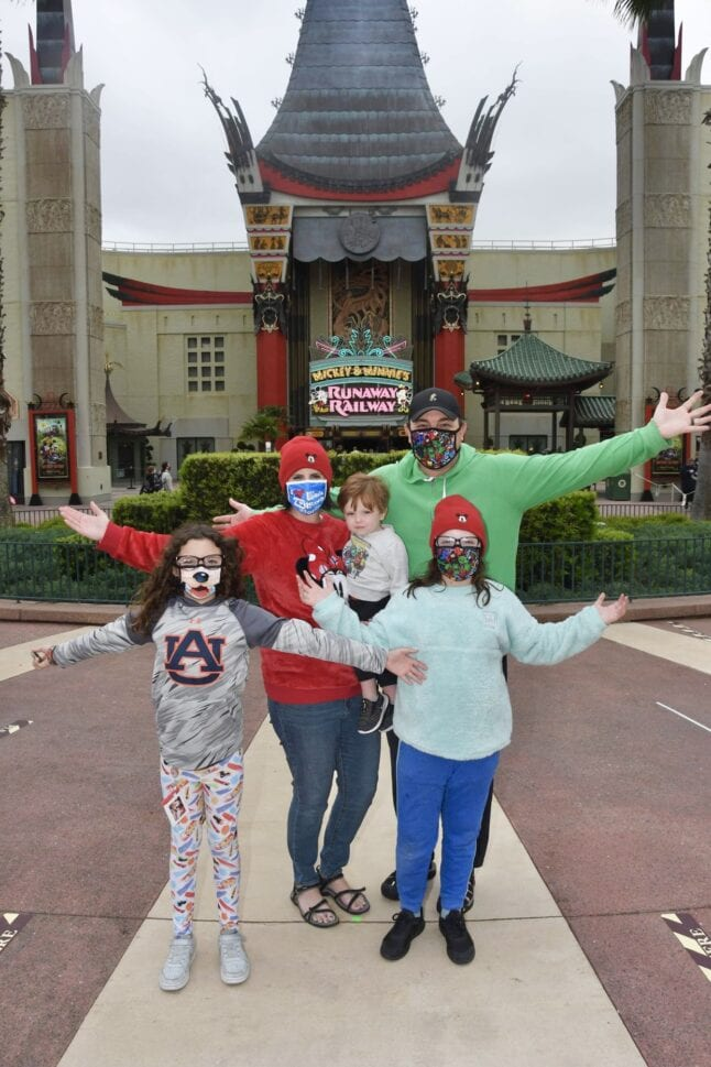 Family photo in Hollywood Studios in front of the Chinese Theater replica.