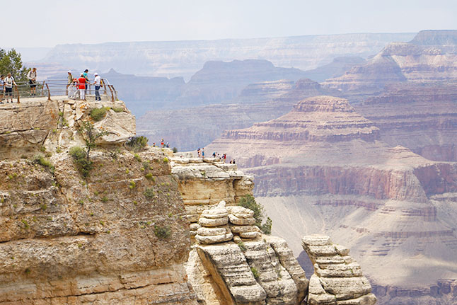 Visitors on the edge of the Grand Canyon